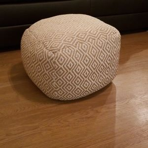 Tan and cream floor pouf